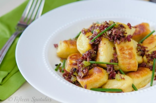 Crispy potato gnocchi with crispy pastrami and chives