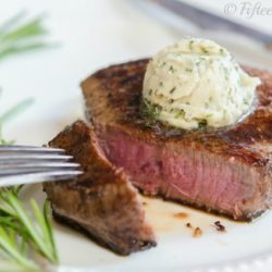 Rare Cooked Steak Cut and Served with Whipped Garlic Herb Butter On Top