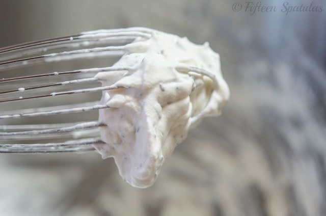 Garlic Herb Whipped Cream in Whisk