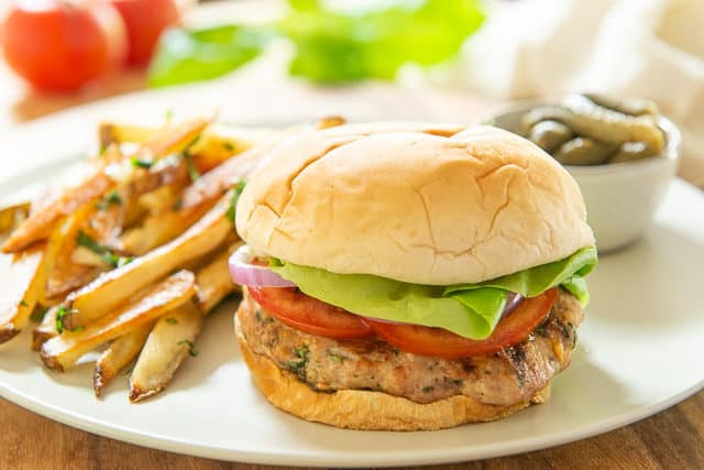 Turkey Burger Recipe - Served on Beige Plate with Pickles and Fries