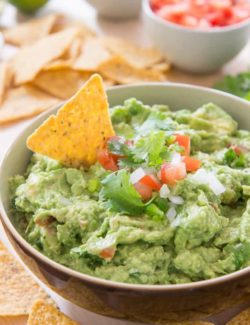 Guacamole - In brown Bowl with Chips on Top and on Side