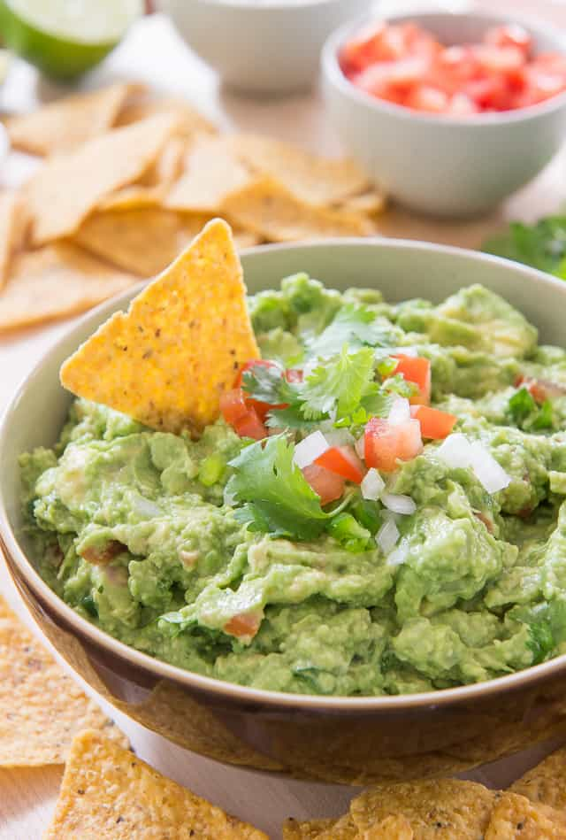 Classic Guacamole - Easy and Delicious! #guacamole #recipe #footballfood #avocado #chips