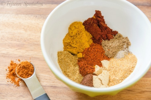 Chicken Thigh Rub - In Bowl with Piles of Spices to Mix Together