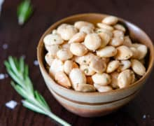 Marcona Almonds Fried in Olive Oil and Rosemary and Served in Brown Bowl