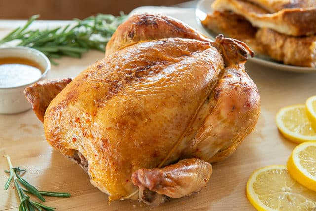 Whole Roasted Chicken stuffed with Lemon, Rosemary, and Garlic
