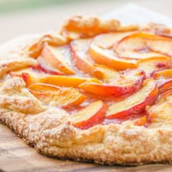 Peach Crostata On a Wooden Board with Sugared Crust