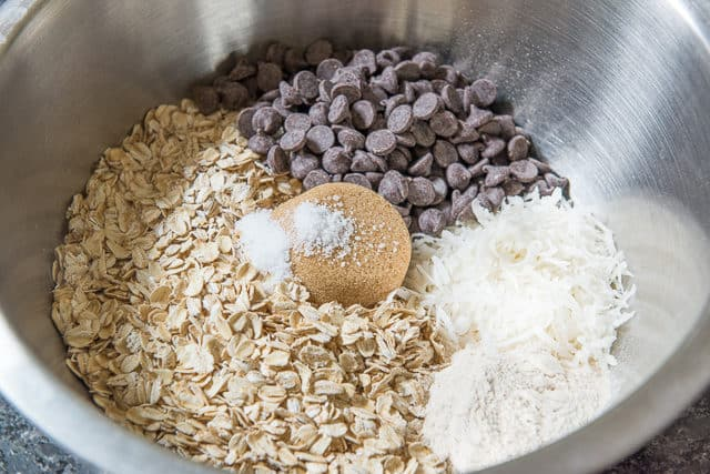Oats, Chocolate Chips, Coconut, Flour, Brown Sugar, and Salt in a Mixing Bowl