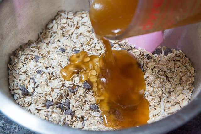 Adding Honey and Oil to the Oat Mixture In Bowl