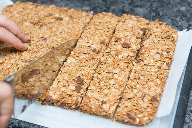 Homemade Chocolate Granola Bars Cut Into Pieces with Knife