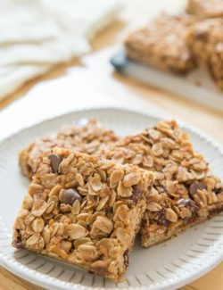 Chocolate Chip Granola Bars on a White Plate in Squares