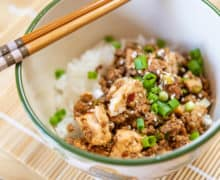 Ground Pork Stir Fry Served in a Bowl With Tofu, Scallions, and Sesame
