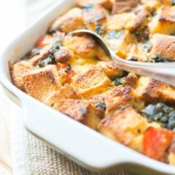 Sausage Breakfast Casserole In a Green Dish with Spoon