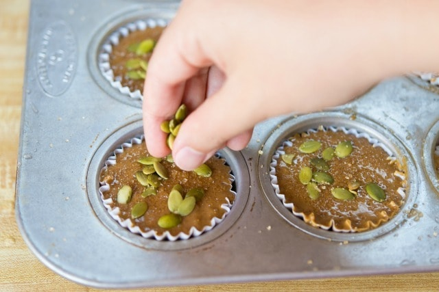 Adding Pumpkin Seeds to the Muffin Batter