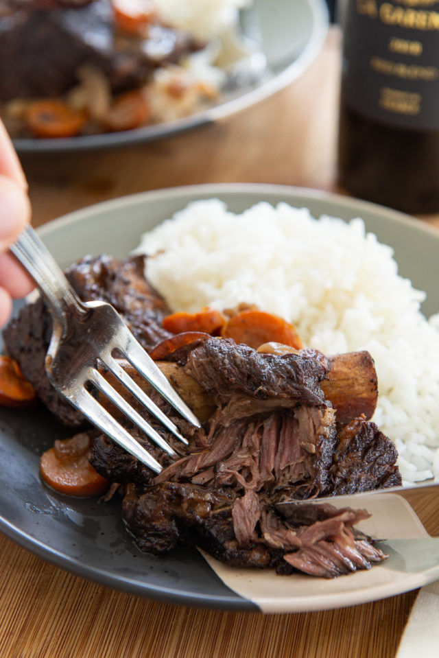 Crockpot Short Ribs - Plated with White Rice and Fork and Knife Showing Texture