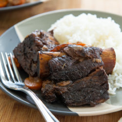 Slow Cooker Short Ribs on a Plate with Rice and a Fork