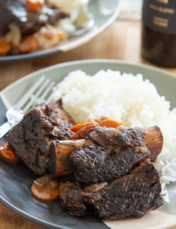 Slow Cooker Short Ribs - On a Plate with White Rice
