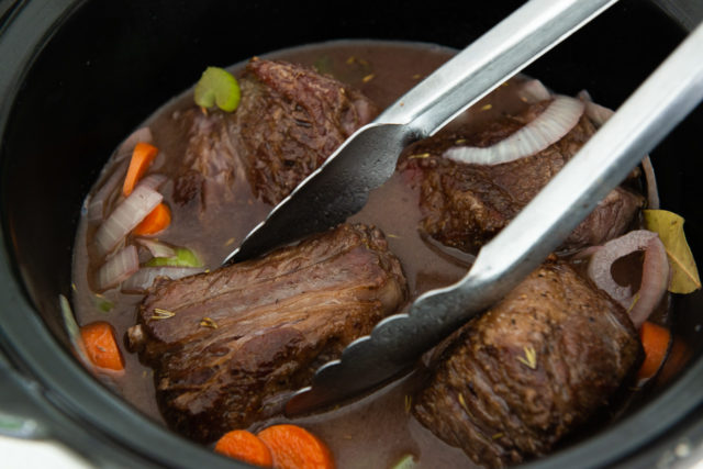 Nestling Short Rib Into Wine Beef Broth in Slow Cooker