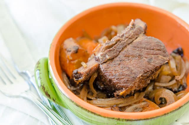 Crockpot Short Ribs - in Green Ceramic Bowl with Carrots and Veggies