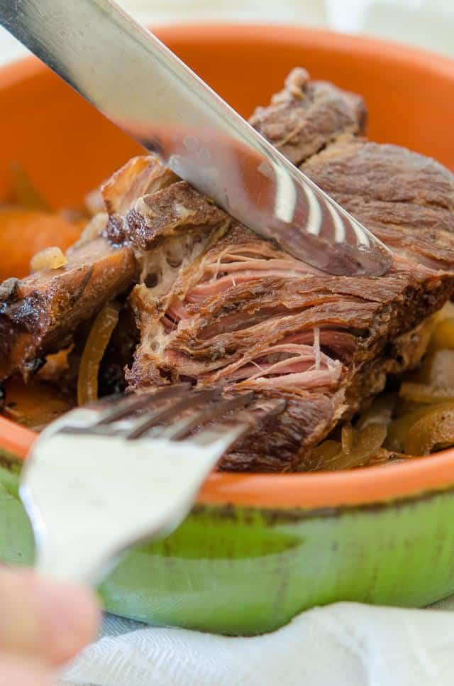 These Slow Cooker Short Ribs are cooked gently in the slow cooker until tender and falling off the bone. They're flavored with red wine and classic vegetables, for an easy and delicious weeknight meal!