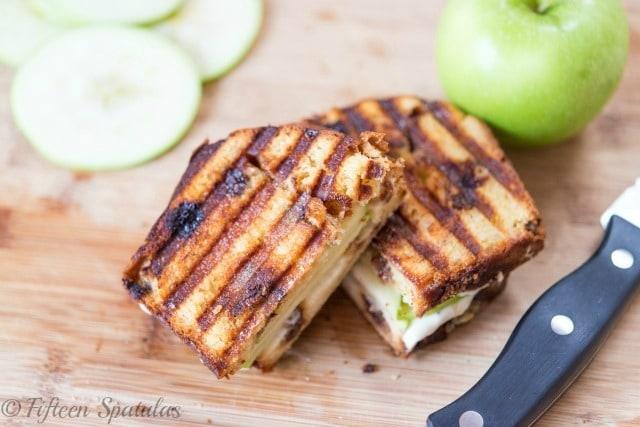 Apple Pie Dessert Panini Cut in Half on Cutting Board
