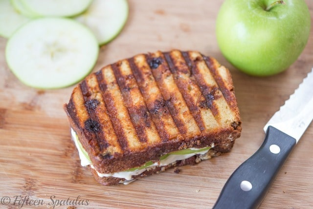 Full Apple Pie Panini on Cutting Board with Apple Slices