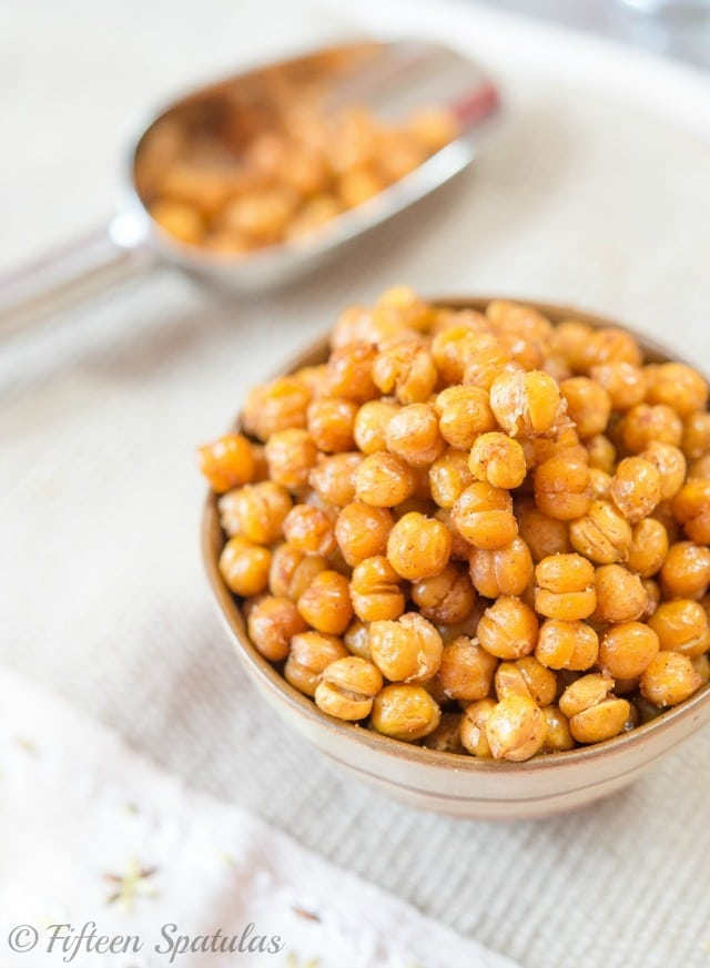 Crispy Baked Chickpeas in Brown bowl with metal Scoop