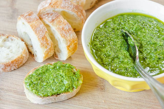 Homemade Pesto - In Bowl with Spoon and Spread on Baguette Slice