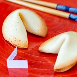 Fortune Cookies On a Red Board with Chopsticks and Paper Decoration