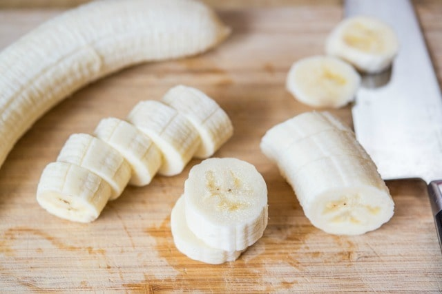 Cutting a Banana Into Slices Before Cooking
