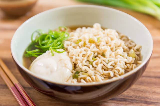 Quick Ramen Noodle Soup From Scratch With Poached Egg, Curly Scallions, In Brown Ceramic Bowl