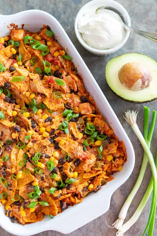 Tex Mex Casserole - In Green Dish with Scallions and Avocado