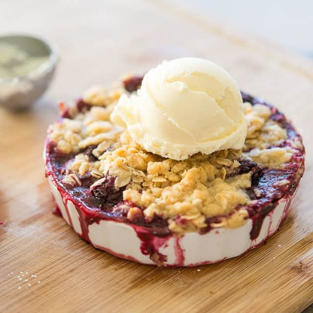 Blackberry Crisp - On Wooden Board with Scoop of Vanilla Ice Cream