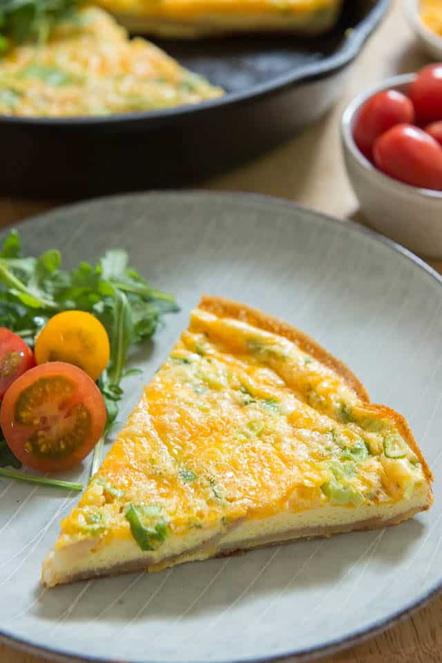 Potato Frittata Recipe - Sliced and Served on Plate with Tomatoes