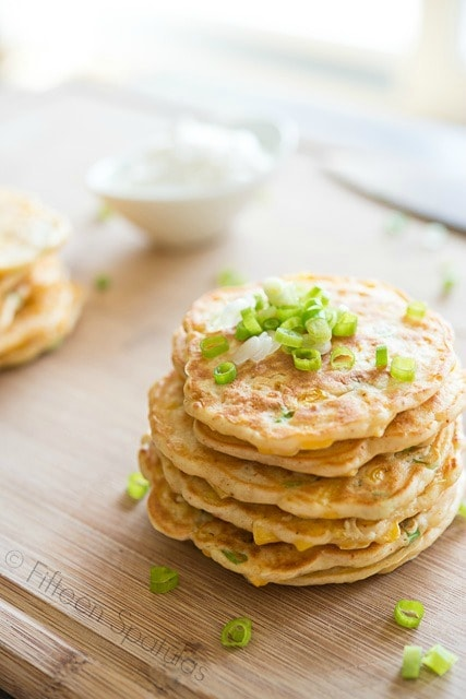 Homemade Corn Cakes on Wooden cutting Board with Green Onions