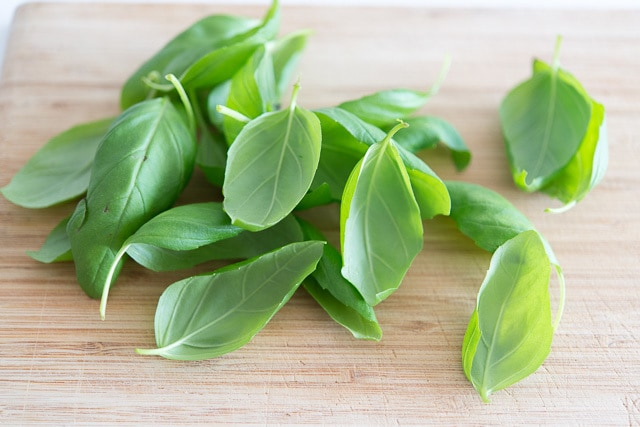 Basil Leaves on a Wooden Board