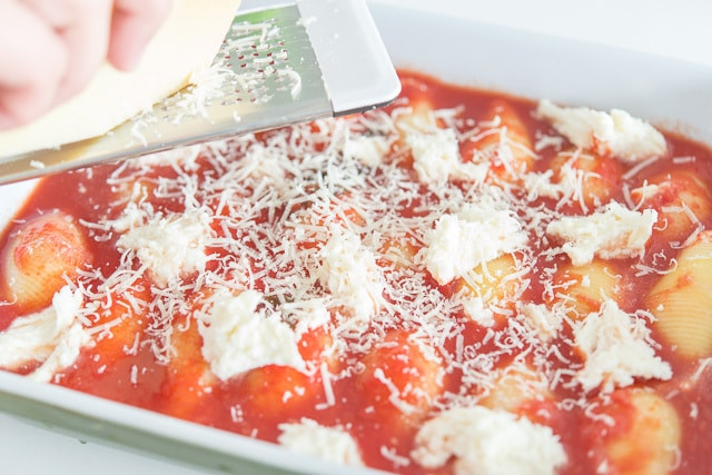 Cheese Stuffed Shells in Tomato Sauce with Cheese Grated On Top