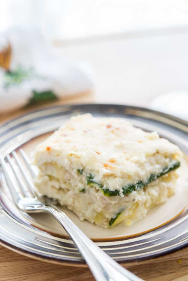 Zucchini Noodle Lasagna - In a Square on Plate with White Sauce