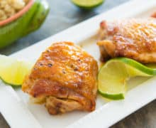 Honey Lime Chicken Thighs - Served on White Platter with Lime wedges