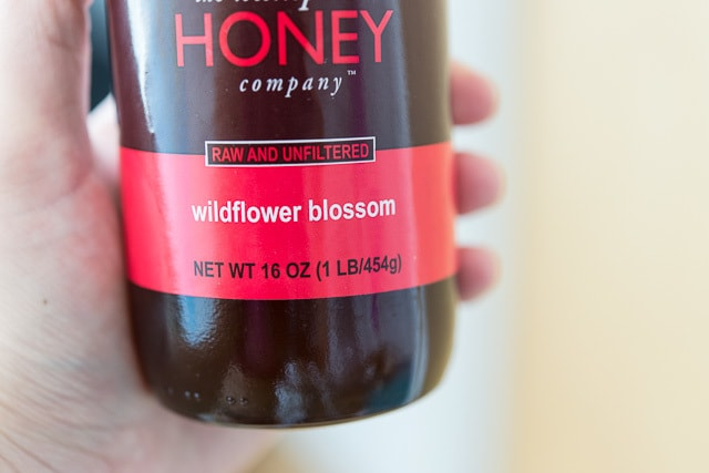 A close up of a bottle of honey