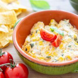 Hot Corn Dip Served in Green Bowl with Roasted Poblano Chiles