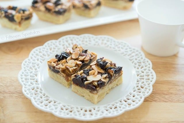 Florentine Cookie Bars with cherries and nuts on lacy plates