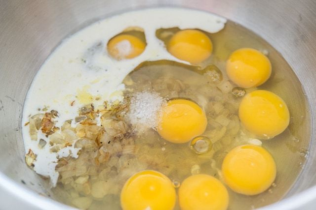 Eggs, Onion, and Dairy in Mixing Bowl