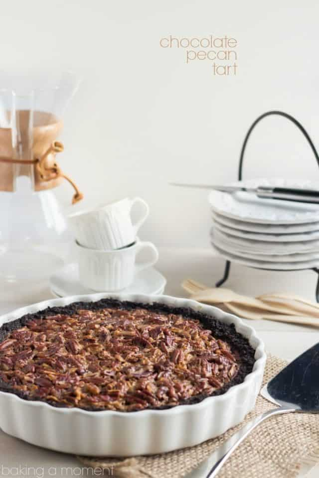 Chocolate Pecan Tart - in White Ceramic Dish with Plates in Background