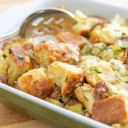 Thanksgiving Stuffing Recipe In a Green Casserole Dish with Spoon