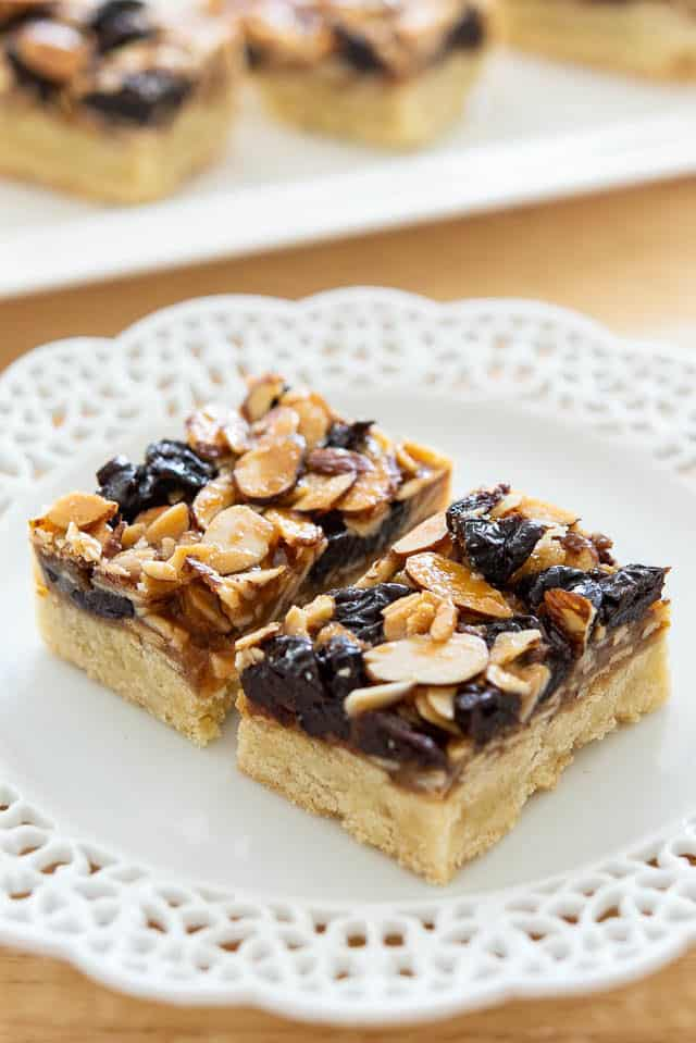 Florentine Bars - On a White Lace Plate with Almonds and Cherries