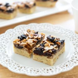 Florentine Bars On a White Lace Plate with Almonds and Cherries