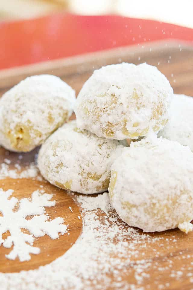 Snowball Cookies - On a Wooden Board with Confectioner\'s Sugar Dusting