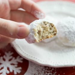 Snowball Cookies On a White Plate with Confectioner's Sugar Dusting