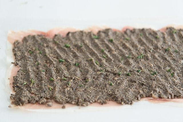 Sheet of Prosciutto with Duxelles On Top with Thyme Leaves