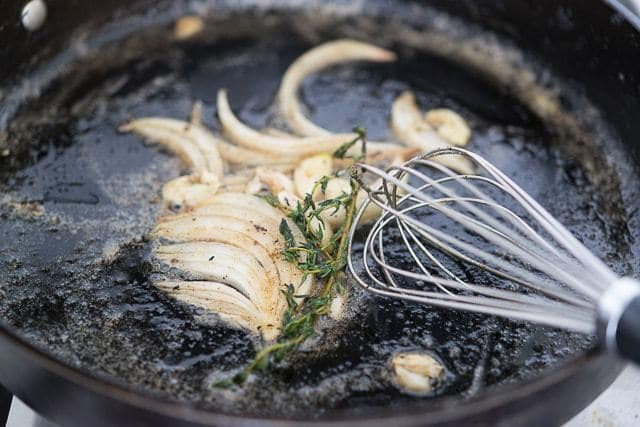 onion, thyme, butter and whisk in pan